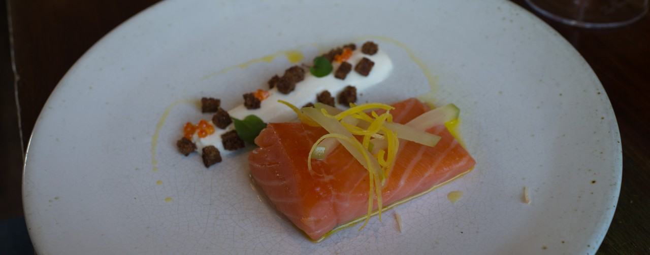 Poached peet smoked salmon with lemon, sour cream and apple