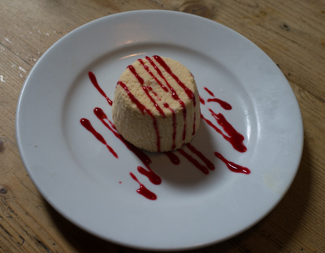 Peanut butter parfait with raspberry coulis